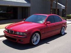 BMW E39 M5 red on AC Schnitzer rims