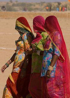 Women walking in the desert.