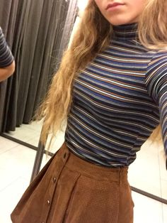Brown button front skirt, blue and brown turtleneck top