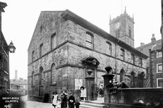 0031 The Parish Church in Holmfirth from 1913. Not much change to the church itself but the building on the left is gone, and the wall is gone.