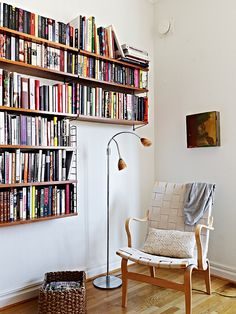 Cozy reading nook with wooden bookshelves