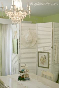 repurposed closet doors for a room divider or to cover hot water tank and/or furnace
