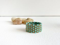 Gorgeous piece! Turquoise peyote ring textured custom band ring by CallOfEarth, $27.00