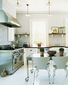pendants + brick and paneling + mahogany counters + stainless steel caster table