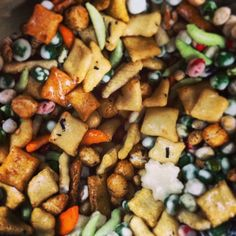 Sweet Noshings in Overton Square is Open. There, you can go for the candy and trail mix jars, the gourmet popcorn, the pre-packaged candy and baked goods, or the Ugly Mug coffee. (Pictured: Wasabi Explosion Trail Mix.)