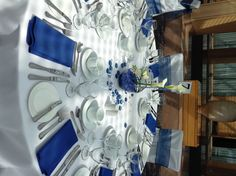 Napkins don't *have* to be folded into fancy shapes to look elegant.  navy blue royal blue wedding centerpieces - Inn at Laurel Point Victoria BC