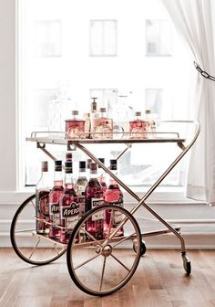 bar cart brimming with pink liquors