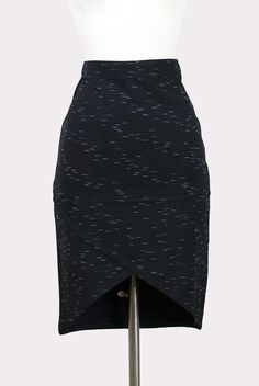 Black fitted skirt with faint horizontal white pattern, wide banded waist, cross-over hem with hi-lo styling. Unlined. - 65% Viscose, 30% Polyester, 4% Elastane, 1% Polyester - Machine wash cold, line