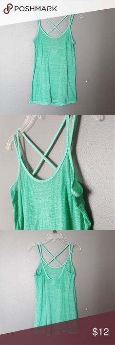 《Mossimo》Teal Criss Cross Tank Top EUC. No rips, stains, holes, etc.  Mossimo brand. Size XS but fits true to a small. Would fit flowy for XS.  Teal criss cross strap tank top. Tighter towards the top, loose towards the bottom.  DON'T WAIT FOR CCO! ADD TO A BUNDLE FOR DISCOUNT SHIPPING OFFER! Mossimo Supply Co. Tops Tank Tops