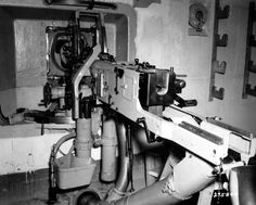 Interior of German coastal artillery casemate, Cherbourg, France, summer 1944. This casemate defended the Cherbourg harbor station and was armed with a Czech-made Skoda 47mm anti tank gun and a MG37 machine gun.Note the solid steel aperture fold. These structures were impervious to all but the heaviest bombardment.