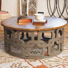"Grey interlocking chain design add dimension to this gorgeous coffee table. Finished with a dark stained table top, this piece is an excellent addition to any sitting room. (18""Hx42""D) Round Chainlink Coffee Table"