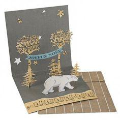 Déambulant tranquillement dans une drôle de forêt, un gros ours blanc fredonne quelques doux airs de Noël, pour une carte de vœux pleine de poésie et de charme. Sur Marie Claire Idées