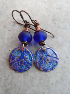 Something Blue ... Patinaed Copper Charms Sea Glass by juliethelen https://www.etsy.com/listing/204943871/something-blue-patinaed-copper-charms?ref=shop_home_active_1  I love this shade of deep ocean blue!  The beautiful design is by Julie Thelen and the lovely lampwork beads are made with antiuque sea glass by Brandy of Beads of the Sea!