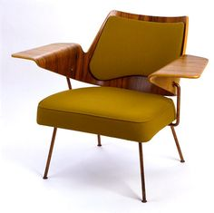 Robin Day.  I love the wing like arms of this chair. the provide plenty of space for a magazine or cup of coffee. I could easily see my self unwinding or starting my weekends with a coffee and a to-do list in this chair.  Repinned by derekeroche.com