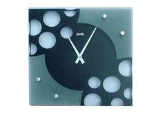 OROLOGIO SETTLER QUADRATO. Orologio muro in metallo di colore nero con un vetro applicato sul fronte che forma un disegno di una caramella