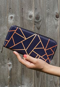 A contemporary purse featuring the stylish and sleek design by Elisabeth Fredriksson, Copper & Midnight. Purse features: - Made using 100% soft and durable vegan leather - Beautiful and unique design printed using vibrant and dynamic colours - Inside features a zipped coin compartment, two open compartments & numerous handy card slots - Size: 10cm x 20cm A chic looking purse printed delicately onto vegan leather. The interior compartments offer an abundance of space with 12 card…