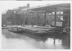 The dock at the factory of J. Lyons & Co. Ltd.     The barges bring tea from the London docks. The barges in this photograph are of 60 tons capacity. [That's much larger than the main Grand Union Canal can cope with.] The dock penetrates into the factory.
