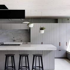 This Fitzroy Loft kitchen by ArchitectsEAT is positively drool worthy.  Leather handles, groved joinery, marble, grey and black accents... The list goes on.... #katewalkerdesign #kwd #kitchendesign #greykitchen #marble #architecture #interiordesign #modern #specifysourcesupply #hardfinishsolutions