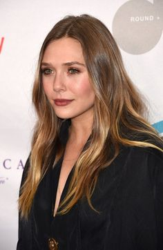 """Elizabeth Olsen Photos Photos - Actress Elizabeth Olsen attends Equality Now's third annual """"Make Equality Reality"""" fundraising gala December 5, 2016 at the Montage Hotel in Beverly Hill, California.  / AFP / Robyn Beck - Equality Now's 3rd Annual 'Make Equality Reality' Gala - Arrivals"""