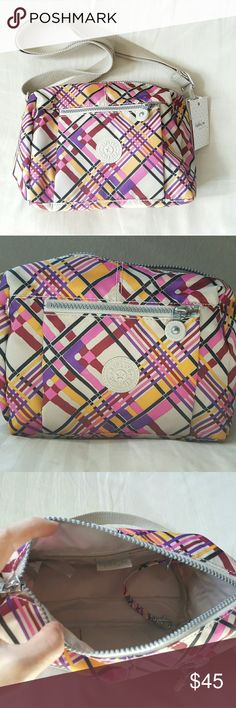 Kipling Crossbody NWT and never used Kipling colorful crossbody.  The inside has a zippered pocket, open pocket, and a place for a pen.  It has one zippered compartment on the front as well. Kipling Bags Crossbody Bags