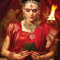 Depicting an Indian Bengali bride except the jewellery which departs from conventional Bengali bride. Description by Pinner Mahua Roy Chowdhury