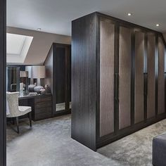 We used upholstered fabric panels on the wardrobe doors in this dressing room to soften all the aisles of joinery #luxuryinteriors #sophiepatersoninteriors #dressingroom #walkinwardrobe #closetgoals #closet