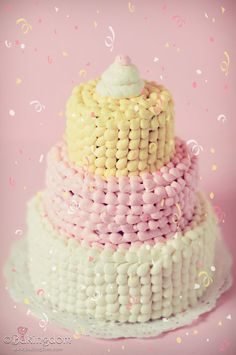 Chocolate cake with my favorite buttercream in swirls and dots and stripes of pretty pink, pale yellow, and simple white.
