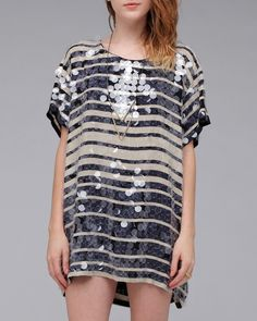 Over-sized T-shirt style dress from Shakuhachi. Features classic boat neck, graduated stripes, and embellished with clear sequins all over.