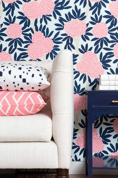 Our most loved pattern now in wallpaper. Classic navy and poppy pink on a soft aqua background combine to create a chic palette with serious style. Paired with