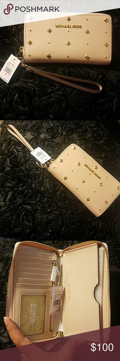 Michael Kors Studded Phone Case Wallet 💜Adorable gold studded wallet has room for 7 Credit cards, inside zipper pocket. Can fit a large phone my Galaxy S7 fits right in the with more room left. 🏵Color Pale pink 🏵Wristlet cord Michael Kors Bags Clutches & Wristlets