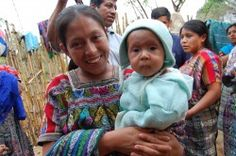 A Trickle Up participant from Guatemala with her baby.