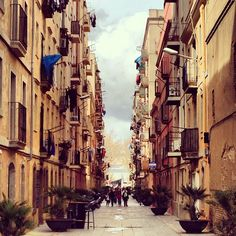 Yellow and narrow streets in Barcelona, Spain