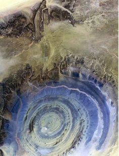 EYE OF AFRICA - MAURITANIA In the Sahara Desert of Mauritania. This natural phenomenon is a richat structure caused by the dome shaped symmetrical uplifting of underlying geology now made visible by millennia of erosion. All Nature, Science And Nature, Amazing Nature, Mother Earth, Mother Nature, To Infinity And Beyond, Natural Phenomena, Natural Wonders, Natural World