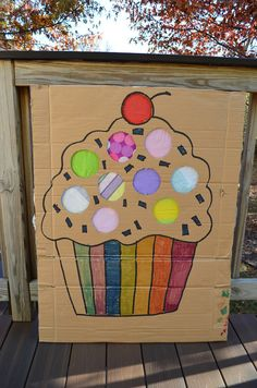 punch out prize game  attach containers to back that hold a small prize, cover with tissue paper.  each child punches though a circle and gets the prize inside.  picture could be anything - made to match patry theme!  Good idea for the Easter Egg hunt