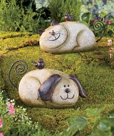 This Stone Garden Friend adds a playful touch to your yard. Its cold cast ceramic body looks like it's made of natural stone. A smiling face and metal accents transform the stone into a familiar animal, and there is even a little bird perched on its back