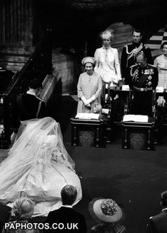 July 29, 1981   Prince Charles and Diana, Princess of Wales, bow to the Queen