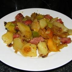 """Sausage & potatoes                              4 slices bacon fried crisp/chopped       4 potatoes, peeled into 1""""cubes    1T dried onion     1/2 t garlic powder    1/2 t salt    1/4 t black pepper    1/4 c bacon grease &  marg. (total amt)    1 (16 ounce) package kielbasa sausage, cut into 1 inch pieces                     Parsleyflakes(optional)"""