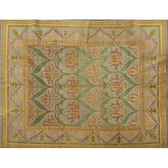 "STYLE OF WILLIAM MORRIS  Contemporary room-size rug in green, mustard and purple floral pattern on French blue field  Unsigned  8"" 9"" x 11"" 9"""