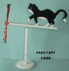 Cat chasing a mouse whirligig.        This is a play on an older design I came up with in the 70's The older design has the cat in a more u...