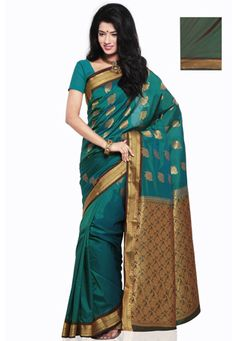 Shot tone teal green art silk zari woven saree. As shown shot tone green art silk blouse fabric is available and the same can be customized from 32 to 42 inches, as the fabric is just drape on the model. (Slight variation in color is possible). data-pin-do=
