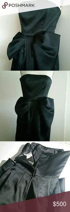"""Victor Costa Gala Dress Size 0 Like new, vintage. Waist 12"""" measured 9"""" down from edge of top, across at top 16"""". Stays at princess bust seams, under bodice 1/2 bow at right and left gives way to wrap curving down towards right hem. Length from waist 36.5"""", hips with 2 darts on each side in back, measuring 18"""", lapped back zipper 14"""" long. Label needs to be reattached as loose. More pics if needed. May fit 0 or 2. See measurements. Victor Costa  Dresses Strapless"""