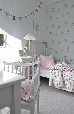 i know its a kids room but I like the wallpaper and pretty florals!