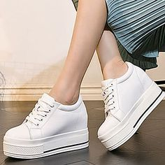 3a906592d Keep up with the wedge heel with this awesome pair of white sneakers. Click  to
