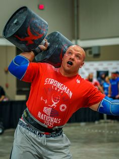 Get Stronger Single-Handedly: Starting with the Strongman Circus Dumbbell - BarBend