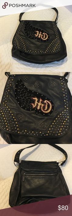 Harley Davidson Satchel Purse w/ Studs Genuine leather Harley Davidson studded satchel purse with a wing design on front that is made of velvet, the studs are brass and silver. There are studs on the shoulder strap.  There is a zipper pocket on the back. Main part is a zipper close, 3 pockets inside. Small zipper and 2 open ones. Gently used. Harley-Davidson Bags Satchels