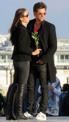 Silly Stamos:Caitlin was later seen holding a red long-stemmed rose as she lovingly looked at her beau. Before the happy pair ventured to the French capital they were spotted in southern Italy's Positano. This comes soon after the news that his show Grandfathered was canceled