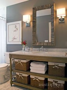 Storage can be tricky in a small bathroom. Use decorative baskets to make storage that's also an accent like this cottage remodel by Austin Bean Design Studio. Click through to find baskets, mirrors, and lamps to recreate this look.