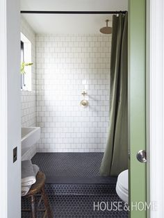 "Splurge on tile that adds texture and pattern to a room. A secondary space was created for an ensuite bathroom. In the ""wet room"" a honed granite slab covers the threshold for a seamless transition into the shower."