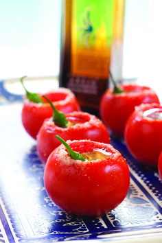 Tomatequila  INGREDIENTS 1 large red tomato, round and firm Salt 1 teaspoon Maggi (found in the Asian or Latin section of the grocery store) 1 teaspoon Worcestershire 1/4 – 1/3 cup (2-3 ounces) good quality tequila, chilled Dash of Tabasco, to taste 1 Serrano chile pepper - See more at: http://goodtaste.tv/recipe/tomatequila/#sthash.Qi3rX55g.dpuf  For a less spicy drink, do not slice the Serrano.