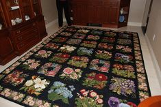 Stunning 35 panel Elizabeth Bradley needlepoint rug with Wild Rose & Forget-Me-Not border